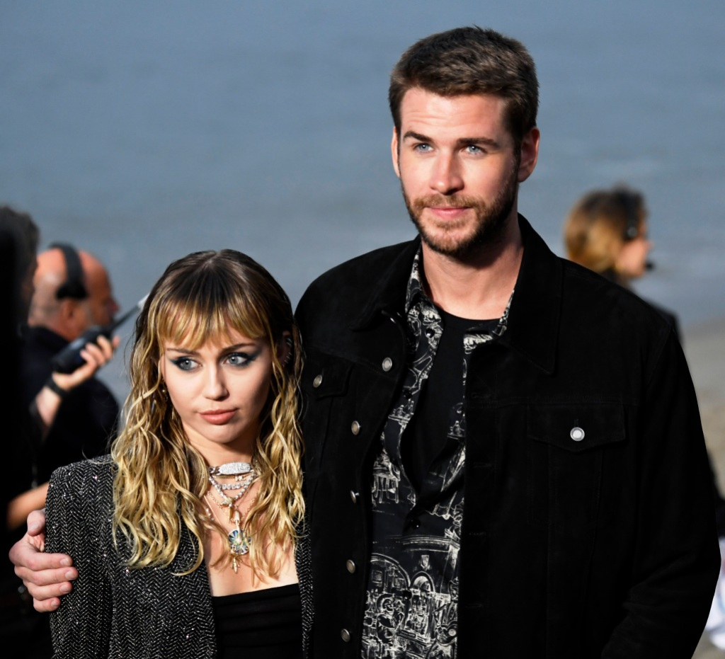 Miley Cyrus and Liam Hemsworth Arm in Arm at Fashion Show Relationship Marriage