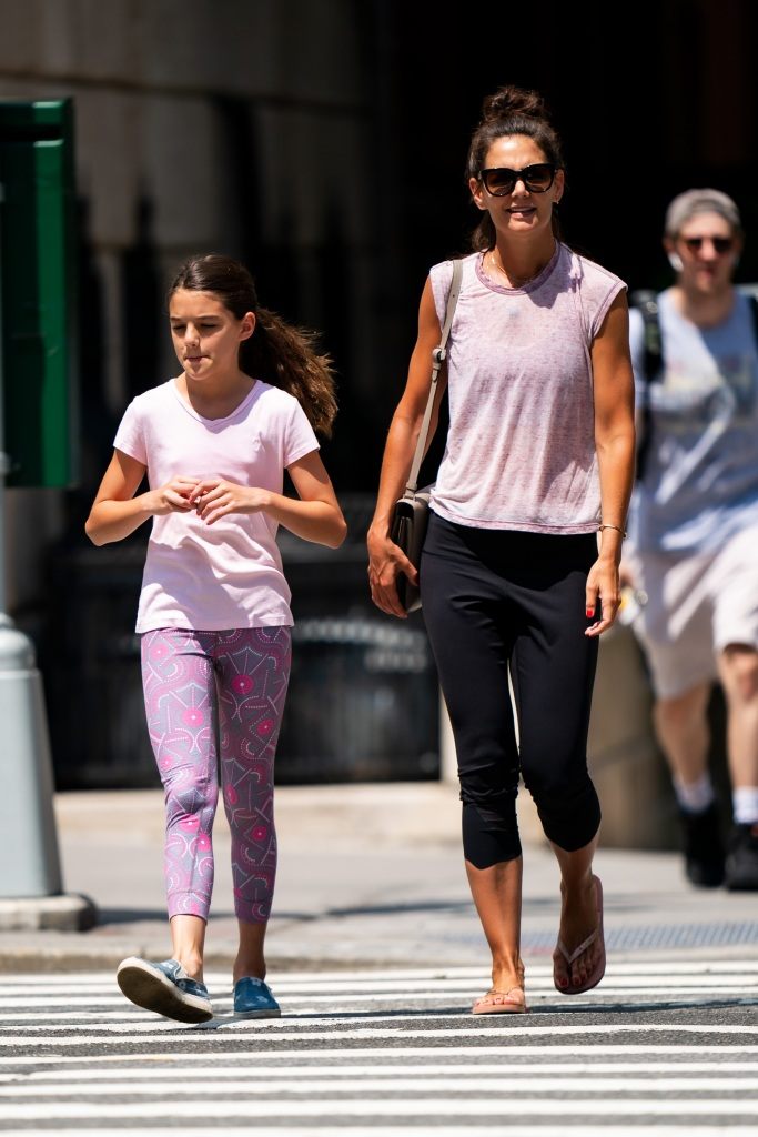 Katie Holmes Wearing a Purple T-Shirt With Leggings Walking With Suri Cruise Wearing Purple