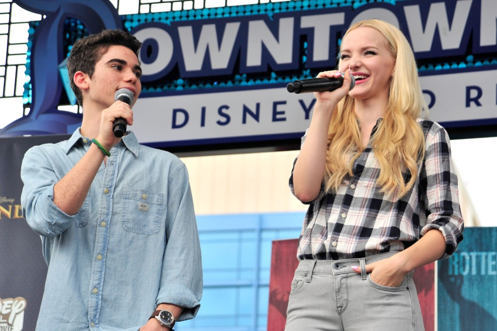 Dove Cameron Wearing a Plaid Shirt With Cameron Boyce in a Blue Shirt With Microphones