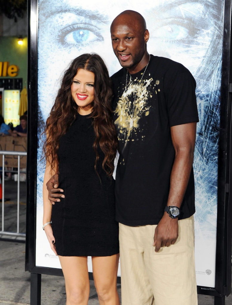 Khloe Kardashian Wearing a Black Outfit With Lamar Odom Also Wearing a Black Shirt With Khakis