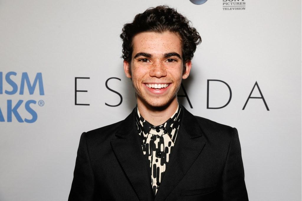 Cameron Boyce Wearing a Black Suit Jacket Smiling