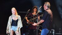 Gwen Stefani Wearing Jean Shorts With a Black Top on Stage with Blake Shelton With His Guitar