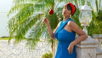 Jackie Gonzales Holds Rose on Private Island