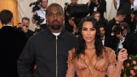 Kim Kardashian Wearing a Beige Dress at the Met Gala With Kanye West in a Hoodie