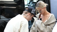Justin Bieber Wears Drew House Tshirt and Tan Shorts While out in Beverly Hills With Hailey Baldwin in Jean Shorts and a White Tank Top and Sunglasses