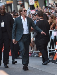 Brad Pitt Waving to a Crowd in a Suit