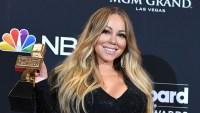 Mariah Carey Holding an Award Wearing a Black Dress