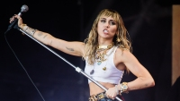 Miley Cyrus Wears White Shirt on Stage