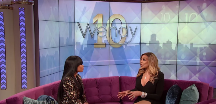 Wendy Williams Wearing a Black Shirt Sitting on the Couch Talking to Blac Chyna