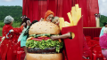 Katy Perry Wearing a Hamburger with Taylor Swift Hugging