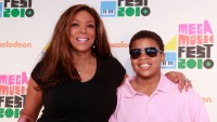 Wendy Williams Wearing a Black Shirt With Her Arm Around Her Son Kevin Jr. With a Pink Shirt on