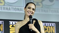 angelina jolie at san diego comic con 2019 wearing a black dress announces her role in the eternals