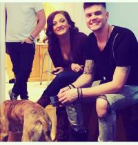 Amber Baltierra wearing a Black Shirt With Brother Tyler Baltierra With a Dog