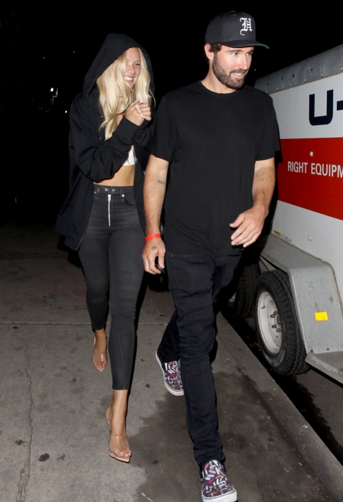 PAID FOR - ONE TIME USE brody jenner wears black pants, black shirt, black hat and sneakers while josie canseco wears black jeans, white crop top, black hoodie and heels on date night