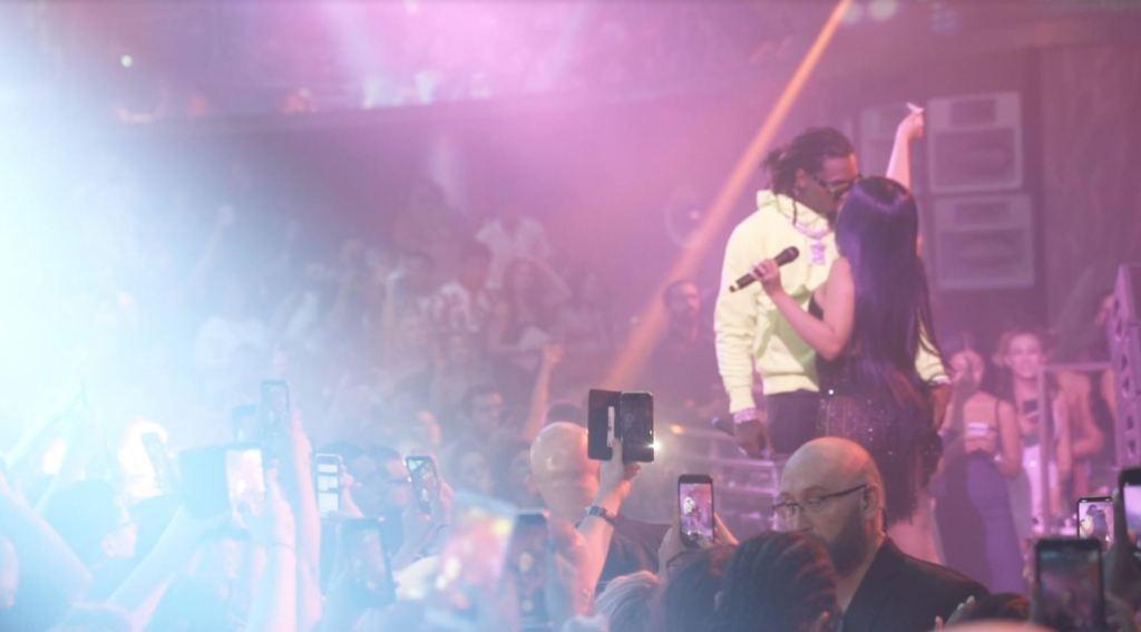 Cardi B kissing her husband, Offset, onstage
