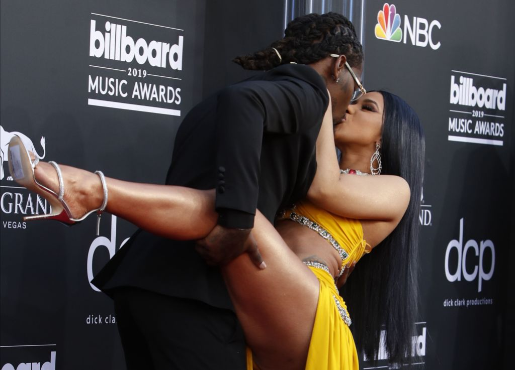 Cardi B Wearing a Yellow Dress With Offset in a Tuxedo