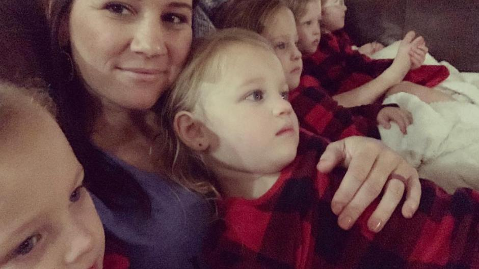 Danielle Busby Cuddles Daughters on the Couch