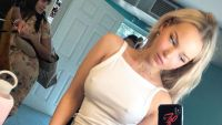Dove Cameron Takes a Selfie With a white Tank