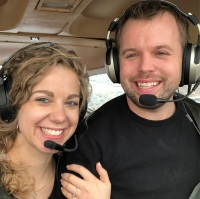 John David Duggar and Abbie Grace Burnett Smiling on His Plane
