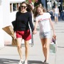 Jennifer Garner Wearing Red Shorts With a Black Shirt With Daughter Violet Holding Hands