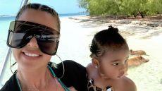 Khloe Kardashian Wearing Sunglasses While Holding True