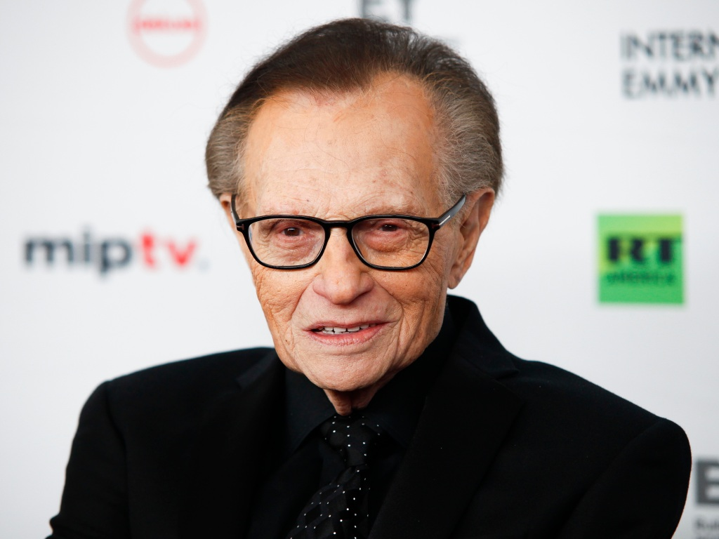 Larry King Wears Black Suit and Glasses on Red Carpet