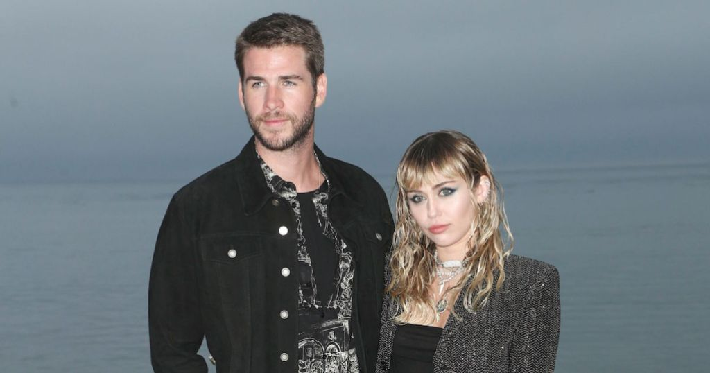 Liam Hemsworth and Miley Cyrus Stand In Front of Water