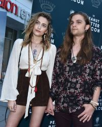 Paris Jackson Wearing a White Top With Shorts on a Carpet and Her Boyfriend Gabriel Wearing a Patterned Shirt