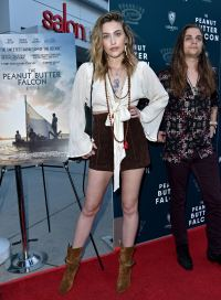 Paris Jackson Wearing a White Top With Shorts on a Carpet