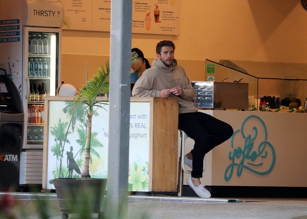 Liam Hemsworth In a Cafe With a Hoodie On