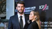 Liam Hemsworth Wearing a Suit With Miley Cyrus Wearing a Black Suit