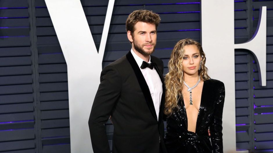 Miley Cyrus With Liam Hemsworth Wearing a Black Outfit