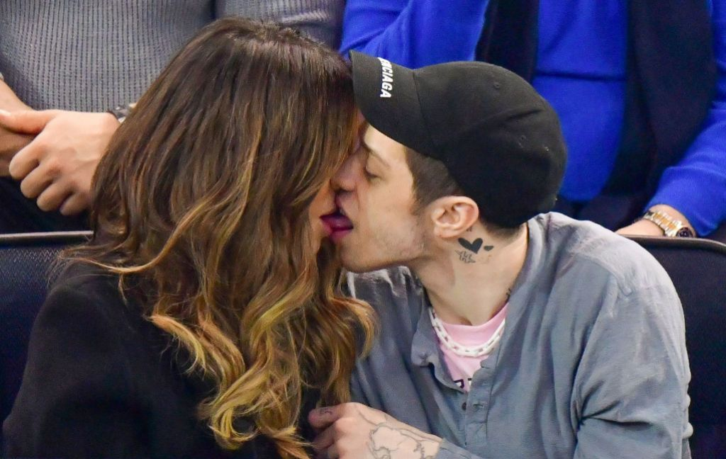 Pete Davidson and Kate Beckinsale kissing at a hockey game