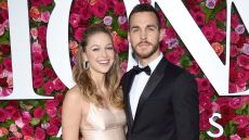 Melissa Benoist and Chris Wood Pose in front of Rose Backdrop on Red Carpet