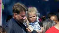 bradley cooper looked casual in gray t shirt, black jacket and jeans as he spent time with his 2 year old daughter lea at disneyland, lea wore a red sweatshirt, a navy blue and white striped shirt and jeans