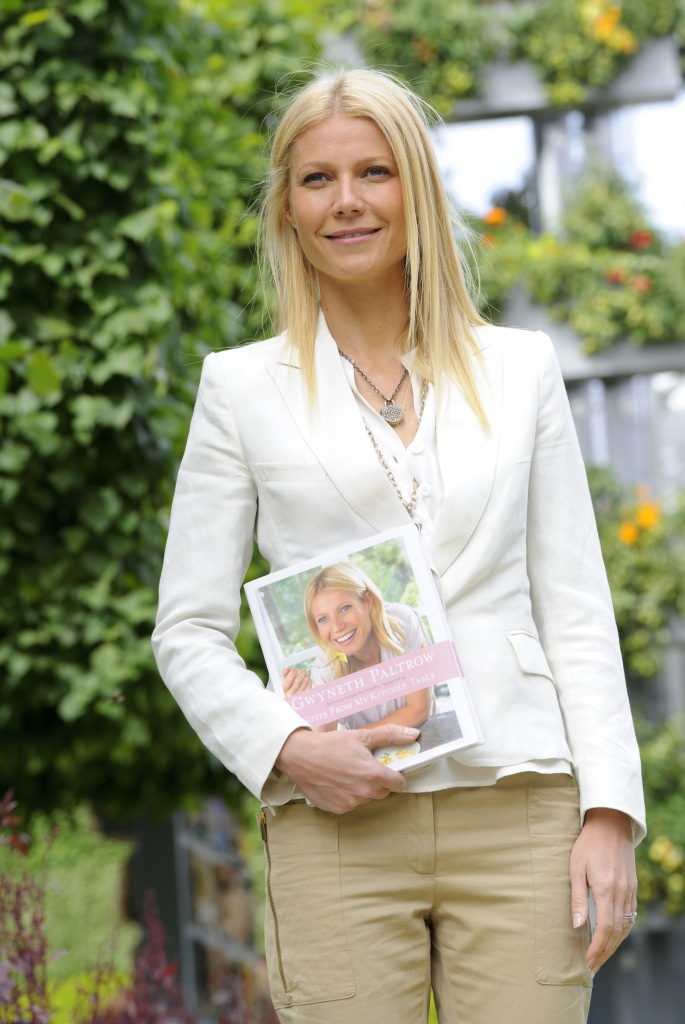 Gwyneth Paltrow Wearing a White Jacket With Beige Pants