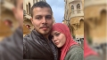 90 day fiance star avery wears salmon pink hijab with a gray coat while omar wears a black leather jacket over plaid button up shirt 90 day fiance are avery and omar married