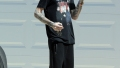 Aaron Carter Wearing Black Outfit Walking Barefoot Outside a Home With His Friend
