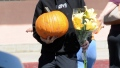 Aaron Carter Carrying Flowers and a Pumpkin Wearing all Black