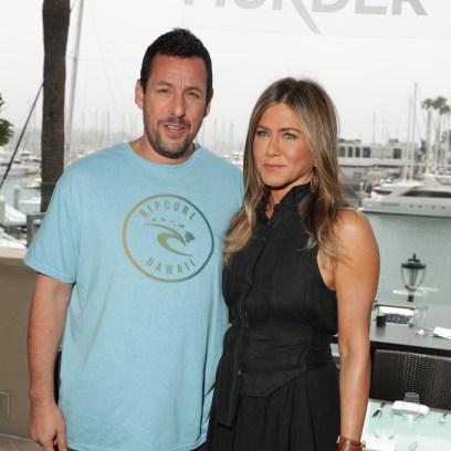 Adam Sandler Wearing a Blue T-Shirt With Jennifer Aniston Wearing a Black Dress