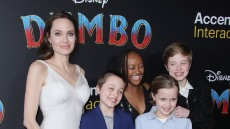 Angelina Jolie Wearing a White Long Dress With Some of Her Kids