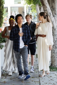 Angelina Jolie Wearing a White Dress Walking With Her Kids Pax Zahara