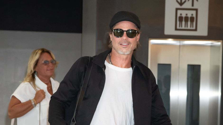 Brad Pitt Wearing a White T-Shirt with Sunglasses in Japan