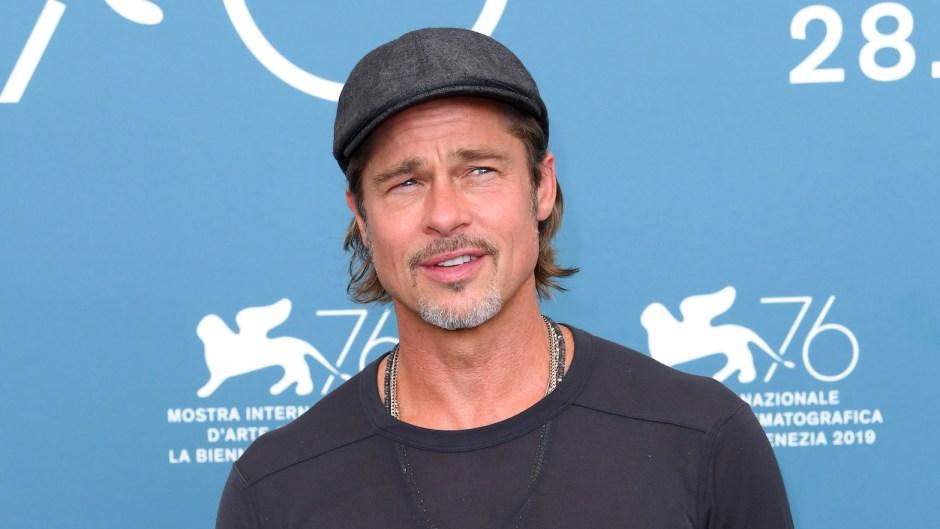 Brad Pitt Wearing a Cap With a Gray T-Shirt