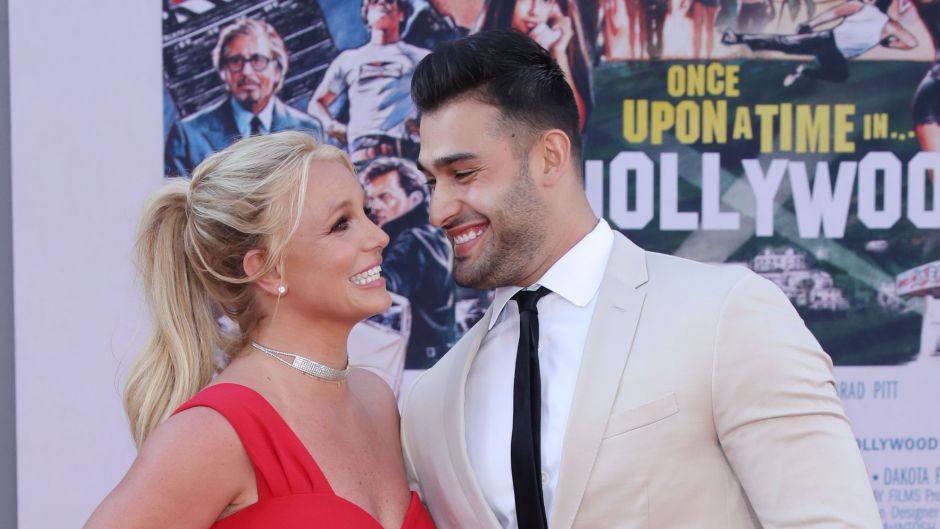 Britney Spears Wearing a Red Dress With Sam Asghari in a White Suit at an Event
