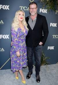 Tori Spelling Wearing a Purple Dress With Dean McDermott in a Suit