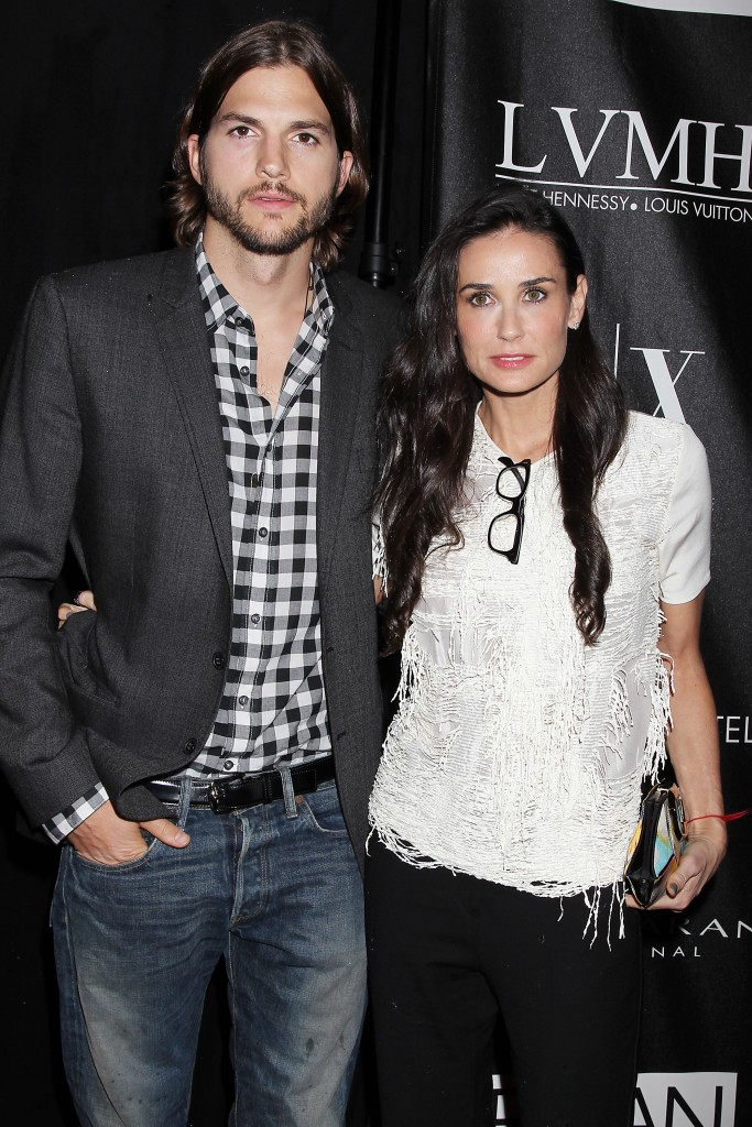 Ashton Kutcher Wearing a Plaid Shirt With Demi Moore in a White Shirt