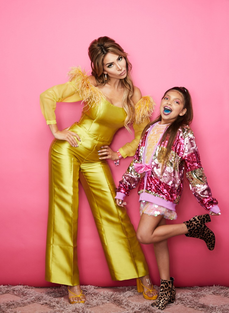 Farrah Abraham Wearing a Yellow Dress With Sophia In a Pink Outfit Sticking Out Her Tongue