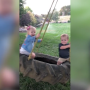 Jacob Roloff Pushes Ember and Jackson on a Tire Swing