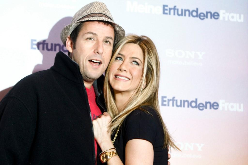 Adam Sandler Wearing a Hat With Jennifer Aniston Wearing a Black Dress